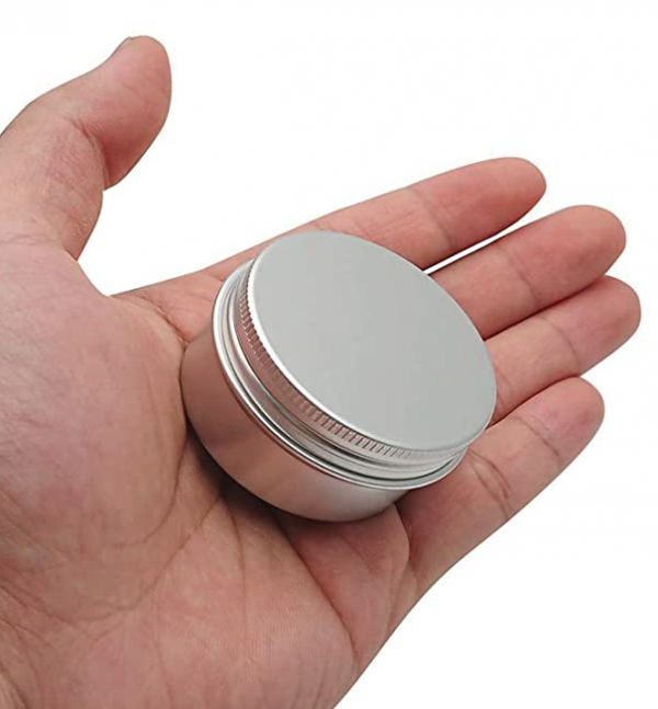 tin container in hand