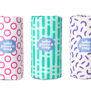 3 double length rolls of paper towels in patterned packaging - white w/ pink circles, teal pattern, & white w/ purple shapes