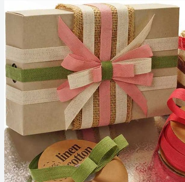 tan box with cream, prink, green ribbon