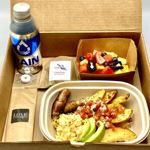 Love Catering breakfast box with Rain aluminum water bottle, fruit, eggs, potatoes, avocado, and sausage